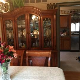 China cabinet and eight piece set of China excellent condition 10 piece set of dinnerware good condition wine glasses and vintage champagne and wine glasses