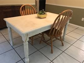 Distressed table.  Shown with two chairs that match the dining table.
