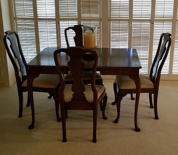 beautiful smaller size drop leaf dining table and four chairs with checked fabric seats