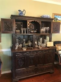 Continental heavily carved oak hutch, Waterford glasses and decanters, cut glass, silver bun warmers