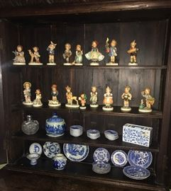 collection of Hummel figurines, blue & white porcelains, cut glass perfume bottle