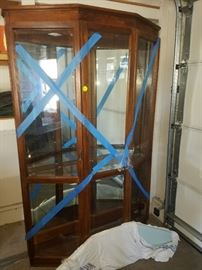 Beautiful although not in this photo...beautiful Curio Cabinet with Glass Shelves. We had it delivered and thus the blue tape.