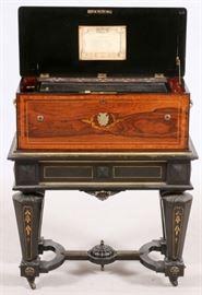 "SWISS ROSEWOOD AND EBONY CYLINDER MUSIC BOX, 19TH CENTURY, H 35"", W 29 1/2"", D 14"" Lot # 0004"