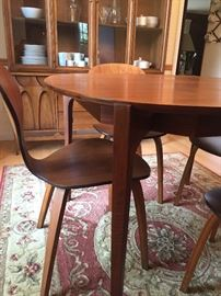 """Mid-Century Modern  Dining table (48"""" round) + leaves, 6 chairs (5 side and 1 arm) - EXCELLENT CONDITION - Also available:  china hutch and sideboard - also shown:  Area Rug"""