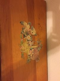 Decoupage emblem at top. Hand done by the husband of the owner, 59 years ago.