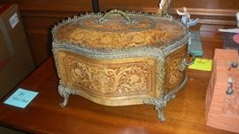 carved wooden box with metal trim