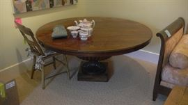 round coffee table, low to ground. comes with side extensions which screw on at bottom