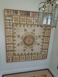large, framed quilt