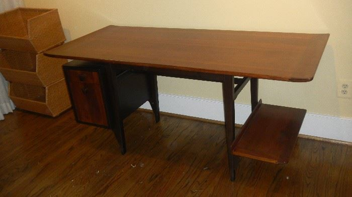 mid century modern desk, beautiful finish, slight curve on top edges. By Dunbar (there is a reserve on this desk, expensive)