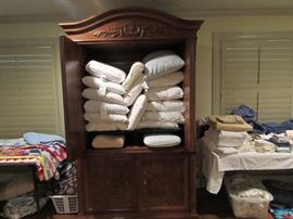 Thomasville cabinet FULL of new and almost new pillows.  Some are tempurpedic.