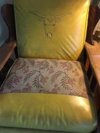 1950s vinyl, cloth and wood yoke-style rocker with embossed longhorn