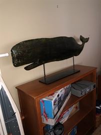 Wooden bookcase and whale mantle decoration
