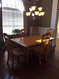 Dining table with 6 chairs (includes pads for the top of table )