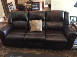 Leather Reclining sofa ( some damage to the head of left side )