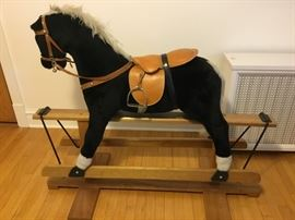 Life size pony with leather seat