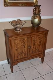 Stenciled Wood Cabinet with Decorative Urn and Basket