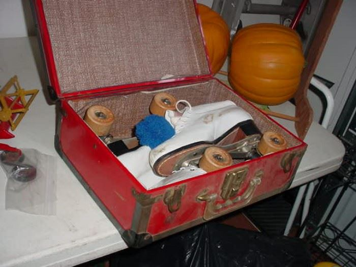 Suitcase with a pair of early roller skates