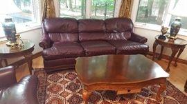 $150  chocolate leather sofa