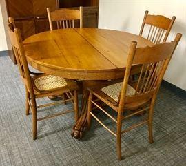 Antique Claw Foot Pedestal Table with Four Pressed Back & Cane Seat Chairs