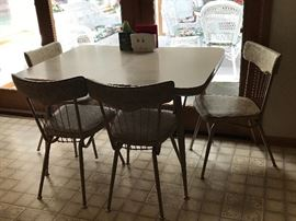 Mid century modern kitchen table and set of 6 chairs.