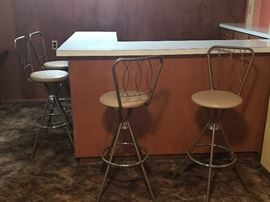These are it! If you are looking for a set of four retro bar stools!