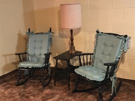 His and hers vintage rocking chairs.