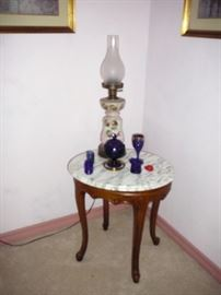 Marble top table with nice oil lamp and knick knacks