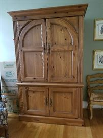 Amazing TV or wardrobe piece.  Available for immediate purchase.  Contact AAA ORGANIZING LLC at 919.422.8589