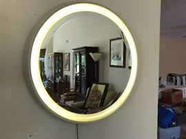 Neon let up mirror a must for any retro home decor.