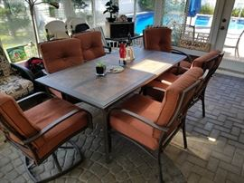 Beautiful patio set like new kept indoors.  Lots of other patio furniture and accessories at the sale.