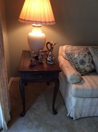 Unique side table with pull out shelf. Deep walnut with scalloped sides - beautiful legs