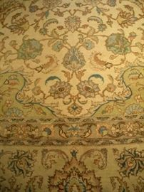 "Living Room: This is a closer view of part of the large hand-made rug's pattern.  It measures 12'  12"" x 19'  5.""   Notice the classic colors of pale greens and golds.  This rug would look great with traditional dark furniture or contemporary furniture--you just need a room big enough to accommodate it!"