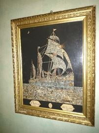 This is artwork of a ship of sea made entirely with Reichspost postage stamps dating in the 1890's