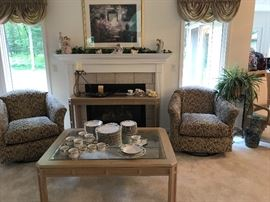 Living Room grouping of chairs, coffee table, sofa table (in front of fireplace), etc.  Set of dishes is by Gibson