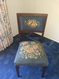 Antique Chair with beautiful floral pattern & grommet accents