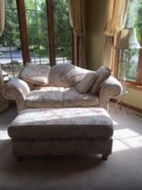 Love seat and matching ottoman. Ottoman top comes off for storage
