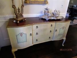 Side buffet in dining room.  3 drawers and 2 doors for easy access.