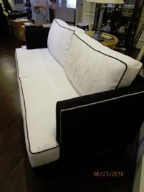 7' Contemporary Style/Hollywood Glam U;ltra Suede Sofa.  Pics show discoloration in one pillow.   Not correctly represented.  There is no discoloration.  It is the camera!