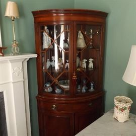 one of a pair of 1940s-50s mahogany corner cabinets