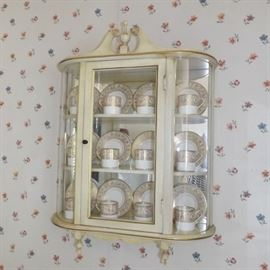 wall curio cabinet with porcelain cups & saucers
