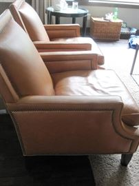 Two Leather Armchairs by Wesley Hall.