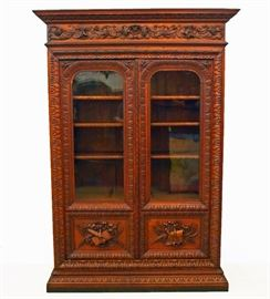 "French Oak Bookcase - A 19th century French carved oak bookcase. The piece measures 59"" wide, 19"" deep, and 94"" high."