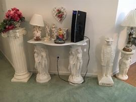 Lots of pedestals with marble tops and statues