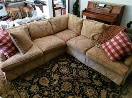 "$300.  Beautiful feather cushion sectional. Gold, cranberry & sage colors.  2 pieces. 103"" x 101"""