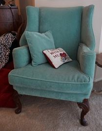 One, of two, antique wingback chairs