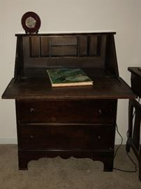 Primitive Secretary features multiple mail slots, and with the drop front door open, serves as an extended Writing Desk.