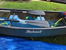 Side view of the Mohawk canoe  including paddles and extras.