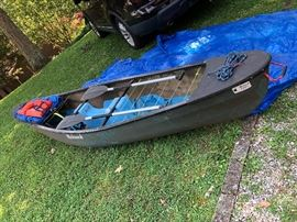 Overall view of the Mohawk canoe   with accessories.