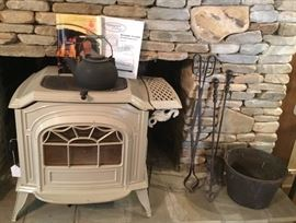 Wood Burning Cast Iron Stove. Check out the cast iron water pot with handle, and the Antique Copper Vessel  on the hearth. A great combination for any fireplace.
