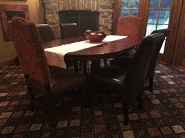 Oval table (some table top damage - name your price) and four leather chairs - set $100